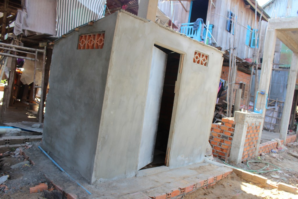 The new toilet in village 2 who was being built with sponsoring materials from Sahmakum Teang Tnaut (STT).