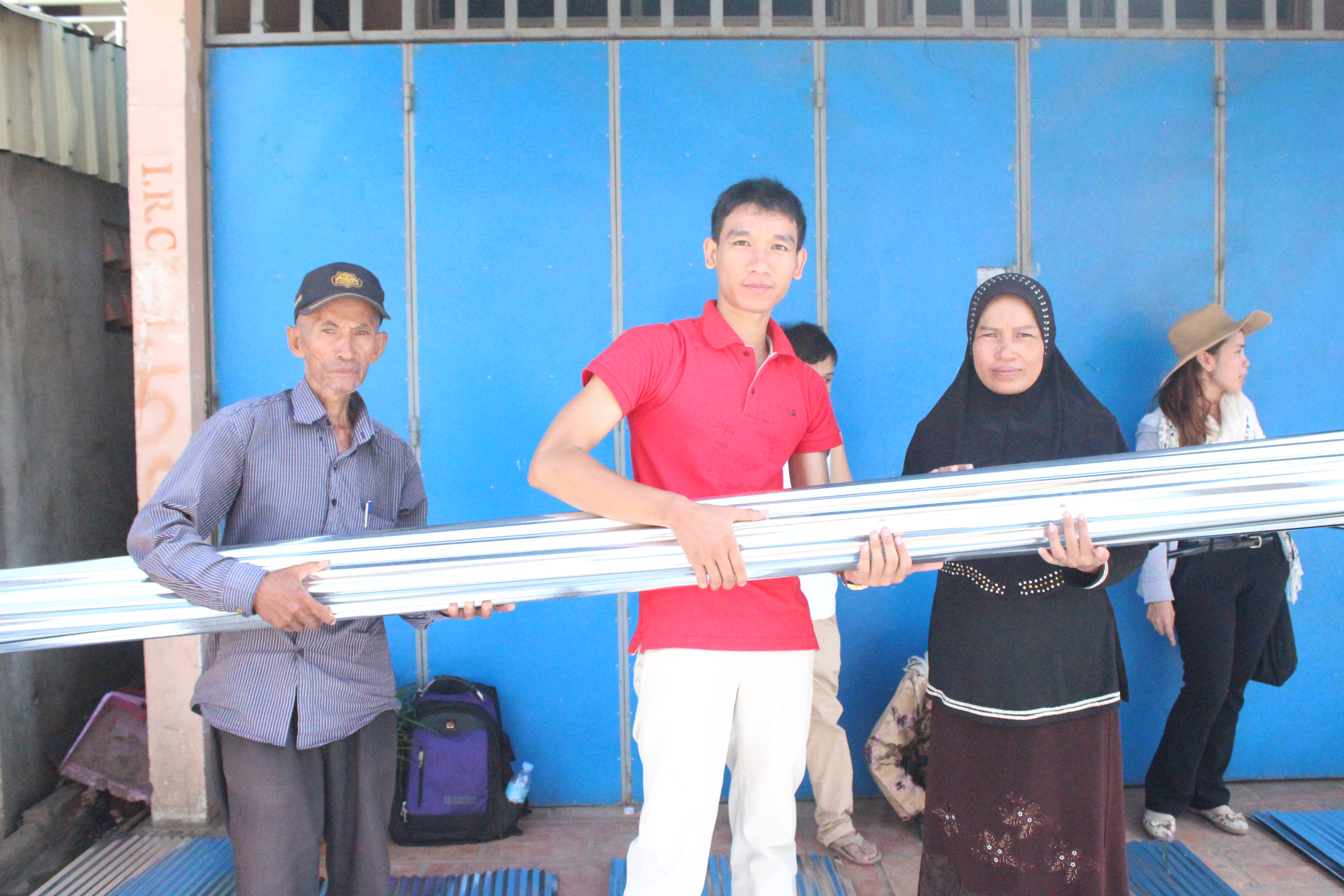 STT's staff distributed metal slates to the project's beneficiaries